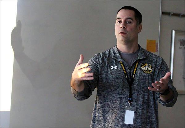 Josh Heinen teaches a science class.