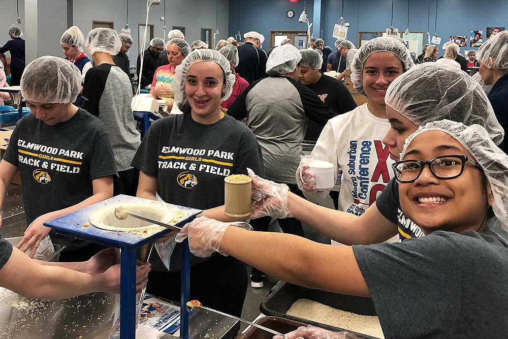 Members of the girls track team pack meal formulas at Feed My Starving Children in Schaumburg.