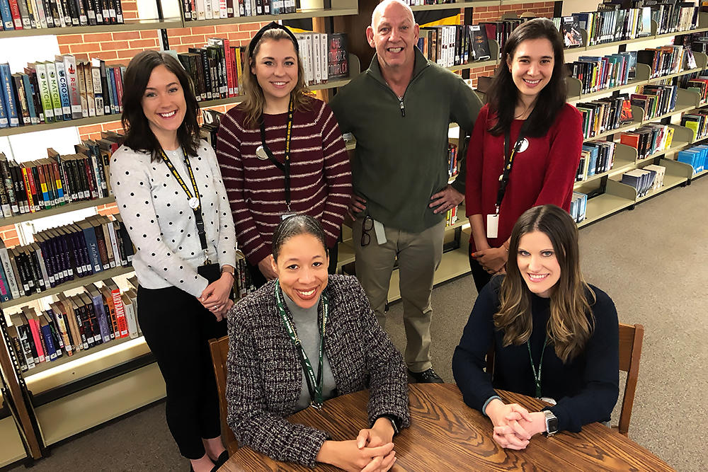 Transition team members Dr. Kari Smith, seated left, and Sara Barrick, seated right; standing from left are Megan Bremer, Agnes Stankiewicz, Paul Fredericks and Nina Limbeck.