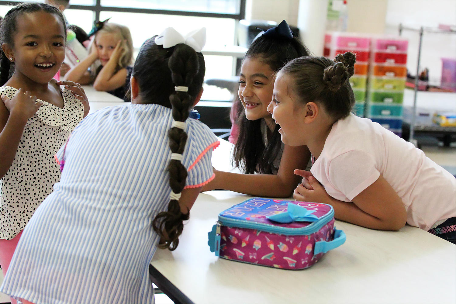 Elmwood students share a laugh during lunchtime in the Elmwood cafeteria.