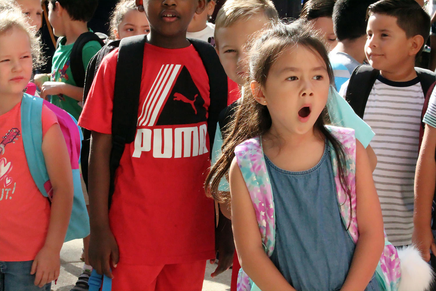 A John Mills student waits in line for the doors to open and a new school year to begin.