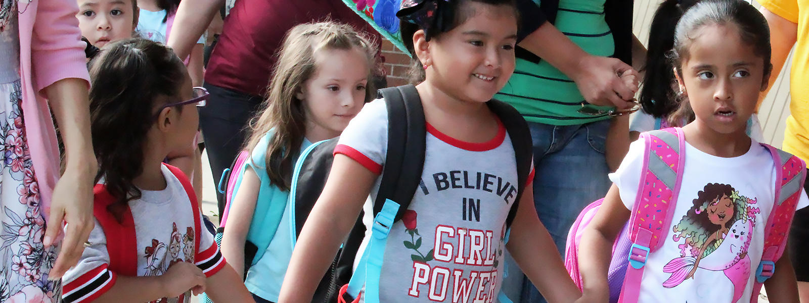 ECC students enter the building for the first day of school, Aug. 14, 2019.