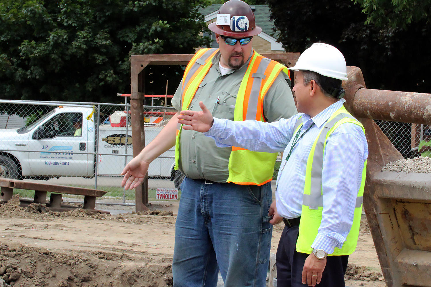Joe Sierra discusses the Elm Middle School construction project with site superintendent Bob Enger.
