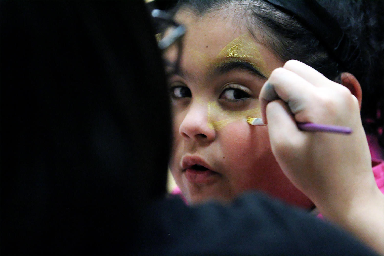A John Mills student gets her face painted at the PTA's Family Fun Fair.