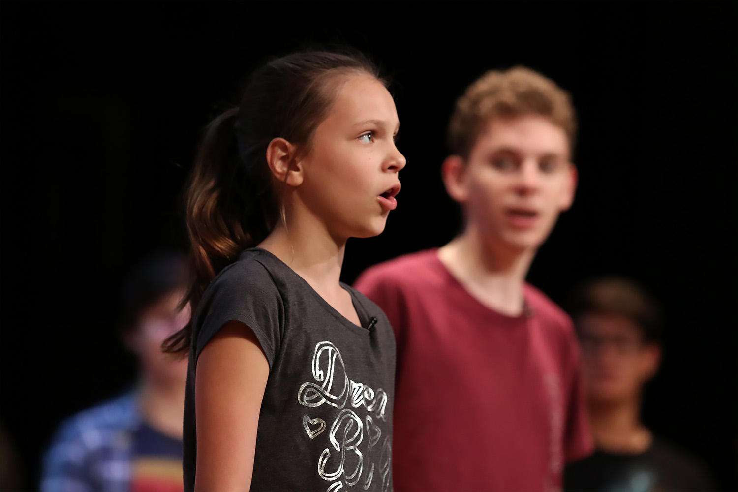 Zoe Rice as Little Ti Moune rehearses a number as Quinn Skelly looks on.