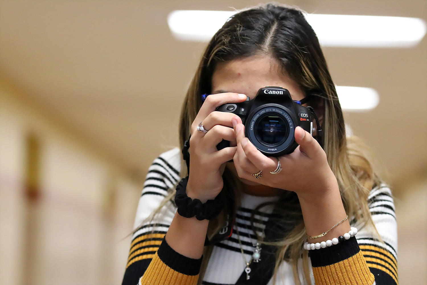 Jessica Pagan takes a photo during Photography class.