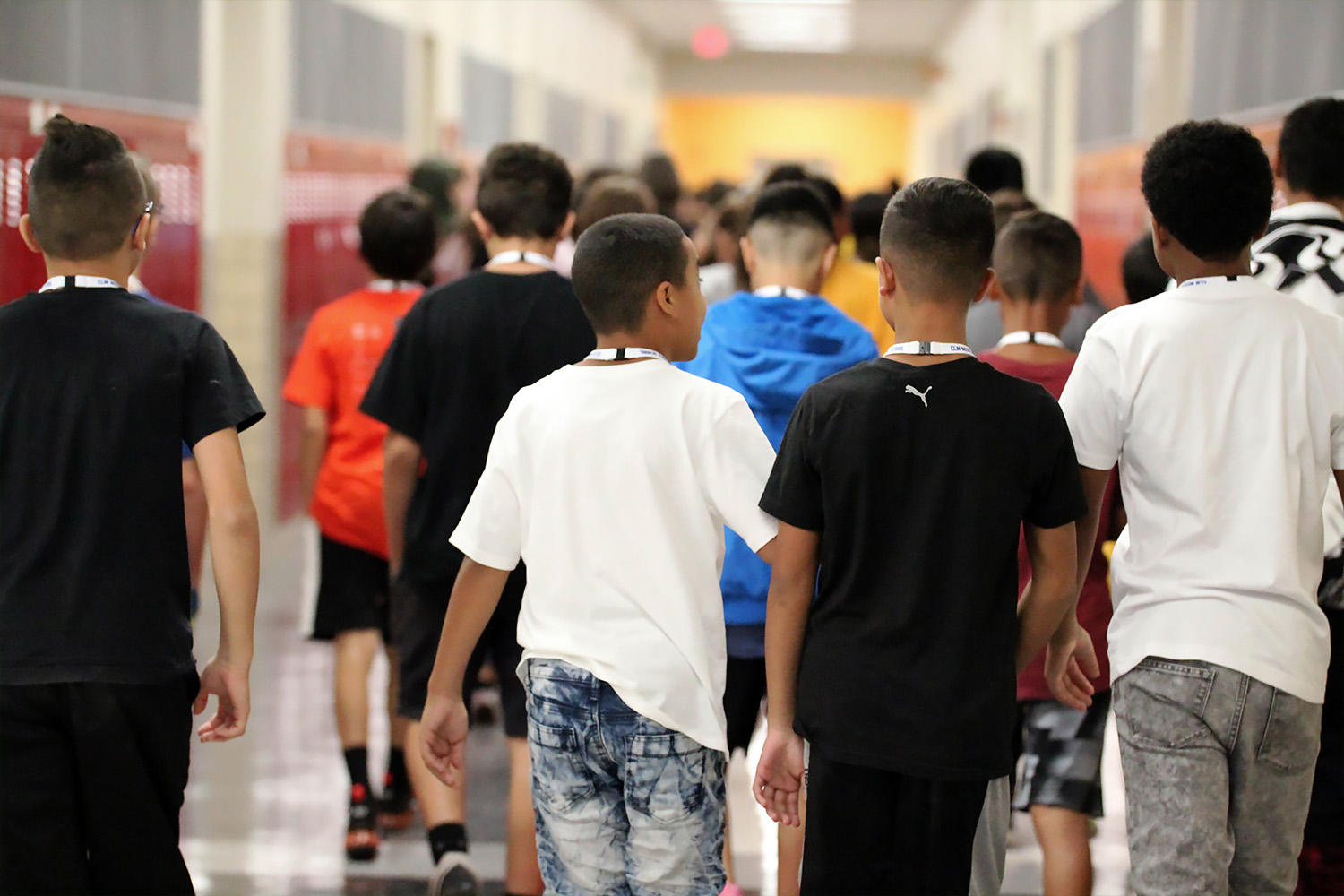 Elm students walk in the school hallways between classes.