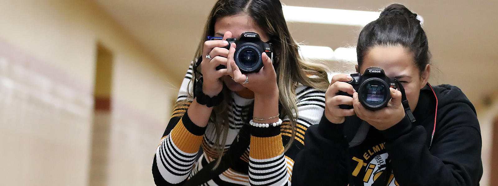 Photography students take photos in the EPHS hallways.