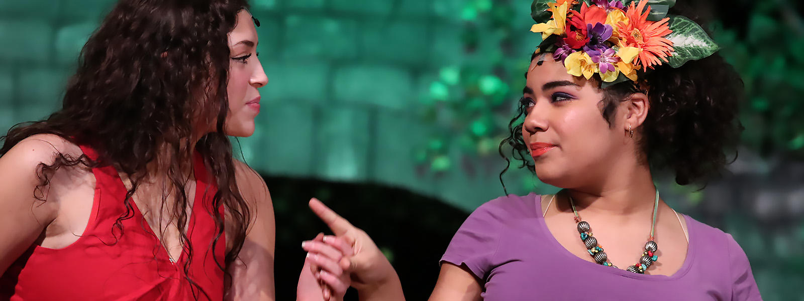 "The peasant girl Ti Moune, played by senior Elizabeth Ruiz-Goranson (left), listens to Asaka, Mother of the Earth, played by freshman Alanis Rivera, in the EPHS production of ""Once on This Island."""