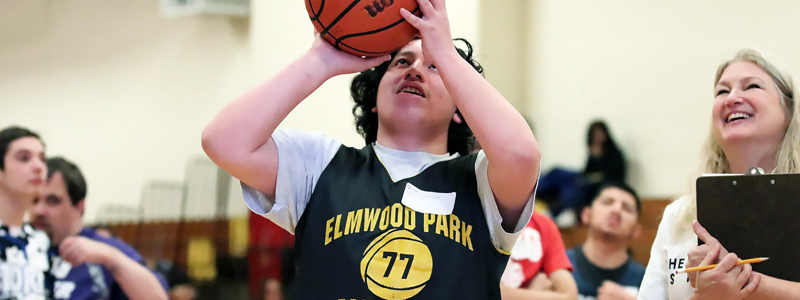 A member of District 401 Special Olympics team displays his basketball shooting skills.