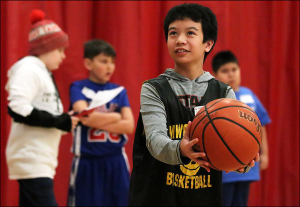 A member of the District 401 Special Olympics team displays his skills at the Dec. 7 basketball event in Hoffman Estates.