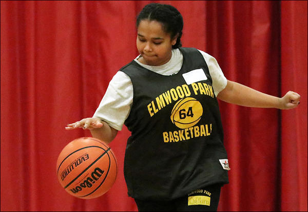 A member of the District 401 Special Olympics team displays her dribbling skills at the Dec. 7 basketball event in Hoffman Estates.