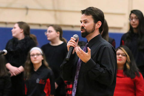 Michael Popplewell, Elm Choir director, addresses the audience at the school's 2019 Winter Concert.