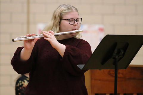 An EPHS guest flutist accompanies the Elm Choir during the school's 2019 Winter Concert.