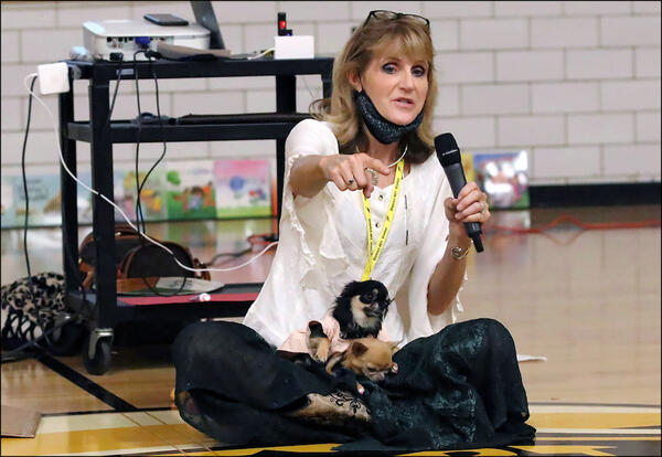 Julia Cook talks with Elmwood students as her dogs Kirby and Tommy look on.