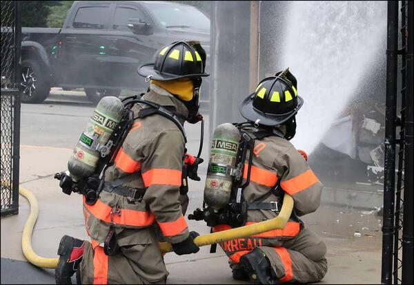 EPFD firefighters extinguish a burn box fire at Elmwood School.