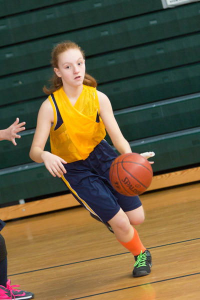 Girl playing in a basketball game