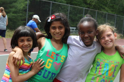 4 girls posing for a picture at summer camp.