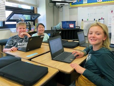 Photos of students using Chromebooks