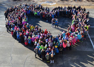 All Westside students formed a heart on their playground.