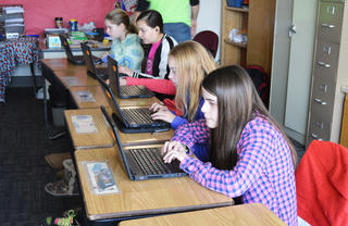 Photo of students using Chromebooks