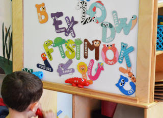 alphabet letters shaped like animals on classroom board