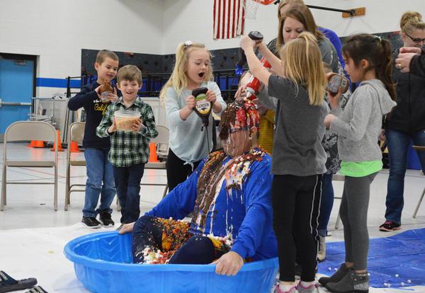 5K Students Turn Their Principal into a Human Sundae as a Reward