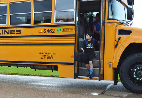 Student getting off a bus