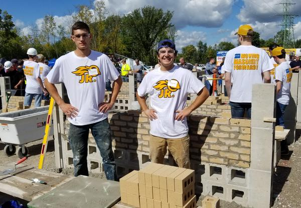 Photo of Andrew Kieffer and Kyle McGrath with their brick project.