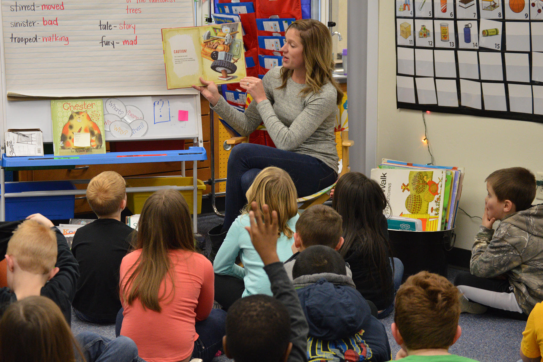 Photo of teacher reading to students at Janssen Elementary School
