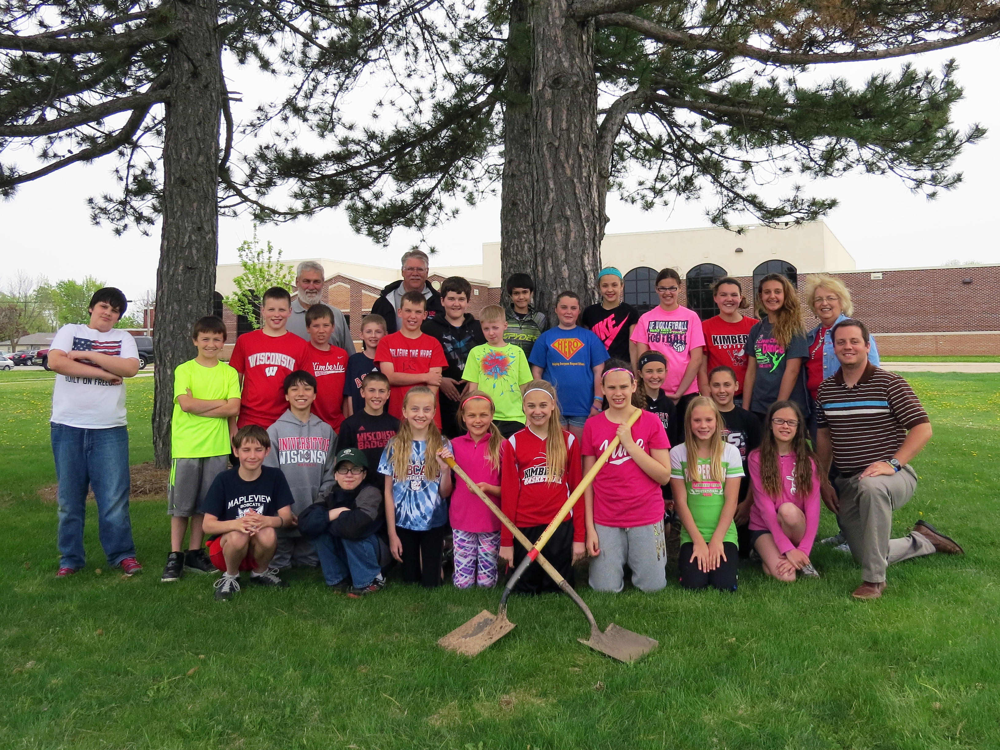 Mapleview students planted trees during Arbor Day 2015 with officials from the Village of Kimberly.
