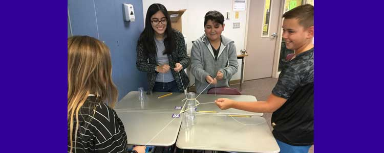 6th grade science students participating in Cup Challenge