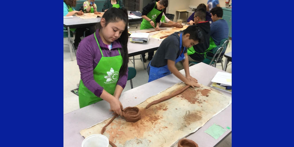 art students working with clay