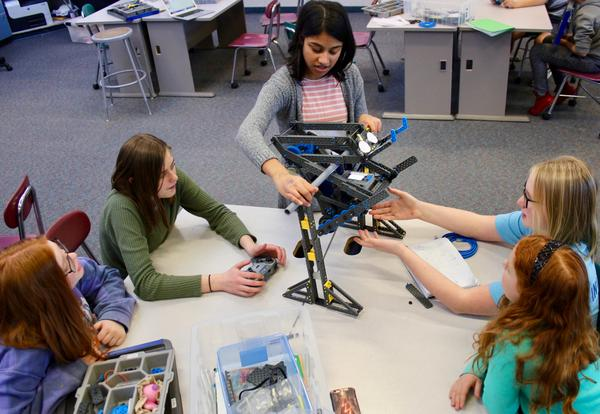 Sophie Macon, Ella Gebers, Miranda Nayak, Alex Dickmann, and Celia Kiezs test their latest design modifications to their robot before the VEX IQ Washington State Championship at CWU on February 23rd.