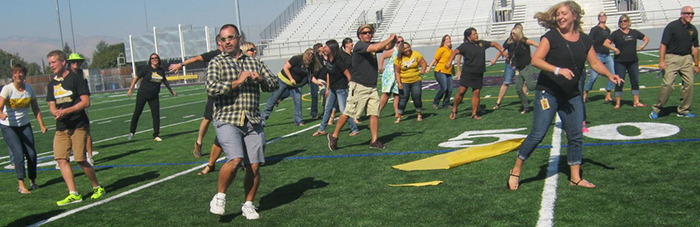 Pioneer students and faculty try out the new Apple Bowl turf.