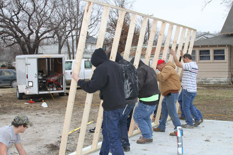 Yet Another Photo of Students Working on Framing the exterior of the Habitat for Humanity House