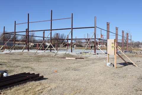 Wide view of half completed steel framework.