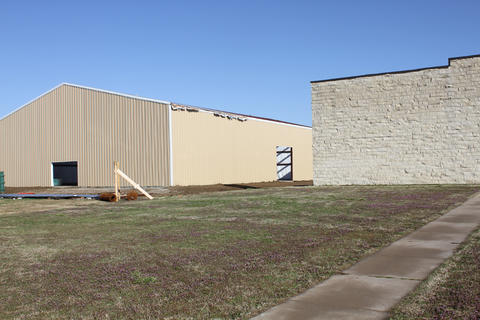 Wide view of metal exterior of building.