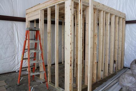 Wooden framework of bathroom inside building.