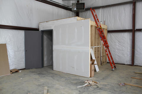 Drywall half installed on bathroom facility.