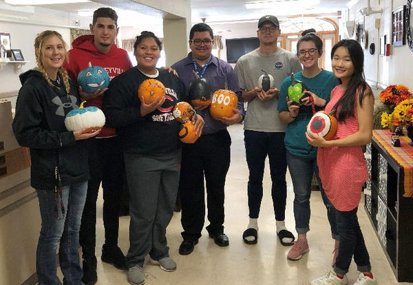 CCC students pose for a photograph while delivering gourds to area nursing homes.