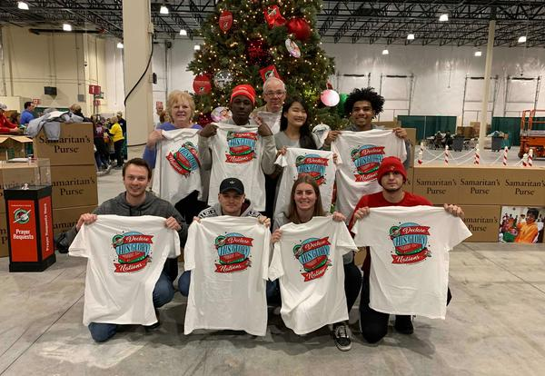 Phi Theta Kappa students posing for a group photo while volunteering at Operation Christmas Child.