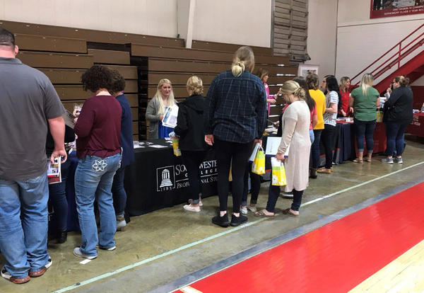 Awesome wide-view picture from behind of students visiting with job and educational reps who attended the nursing career fair on March 27.