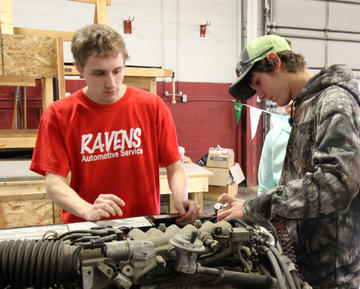 Automotive Student Showing High School Prospective Student How to Use Volt Meter