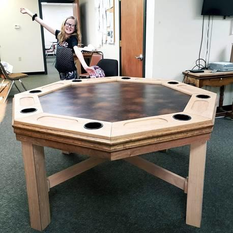 Hand-crafted game and dining table, dark top with seating for 8