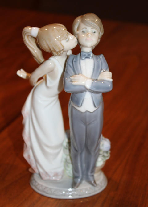 """""""Lets Make Up"""" figurine showing a girl kissing a young lad"""