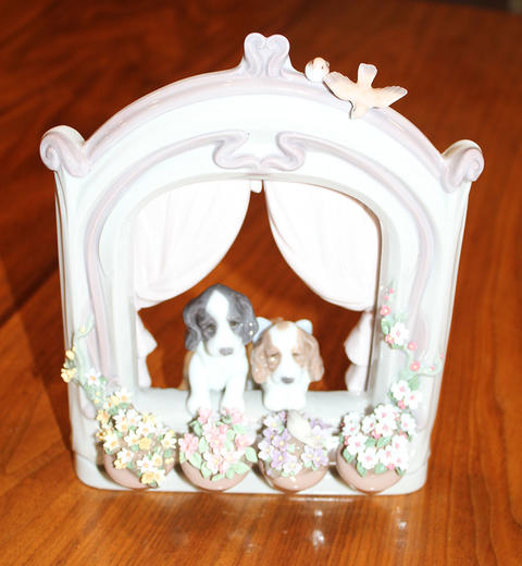 """""""Please Come Home"""" figurine showing two dogs looking out of window, looking pensively for their owner to come home."""