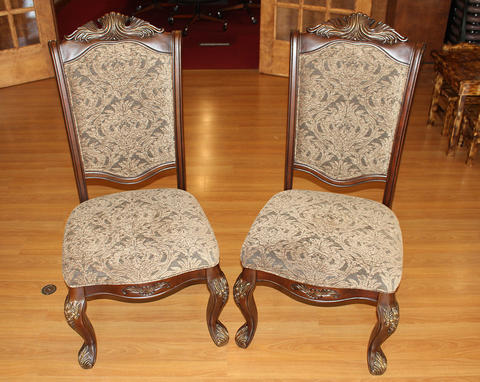 Two queen chairs, dark wood with a greenish-grayish pattern upholstery.