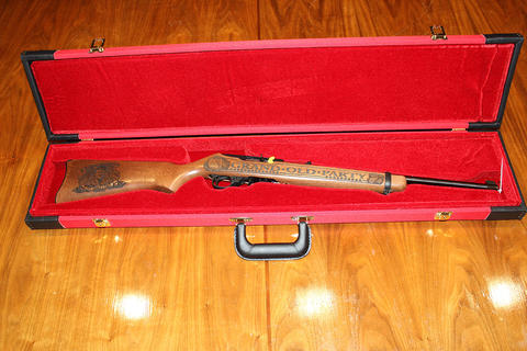 Ruger Grand Old Party .22 auto long rifle and case, etching of Donald Trump on butt of gun.