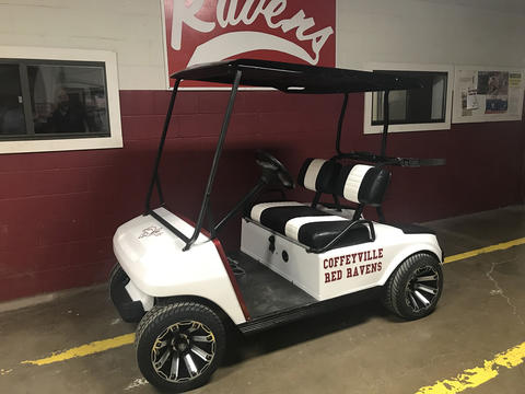 Side View of Red Raven Golf Cart - White with Red Lettering and Red Decals